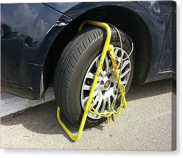 Car Clamped For Illegal Parking Canvas Print