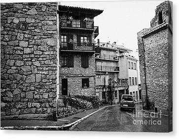 Car Driving Through Narrow Streets Of Old Town Of Medieval Baga Catalonia Spain Canvas Print by Joe Fox