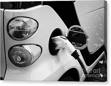 Sharing Canvas Print - car sharing car2go electric car charging at a parking spot in Vancouver BC Canada by Joe Fox