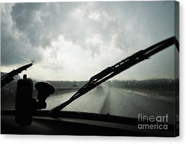 Car Windshield By Heavy Rains On Road Canvas Print by Sami Sarkis