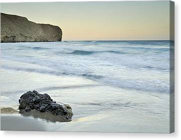 Caresses By The Sea Canvas Print by Guido Montanes Castillo