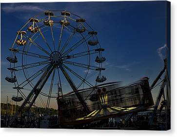 Ferris Wheel And Carnival Rides At Dusk Canvas Print