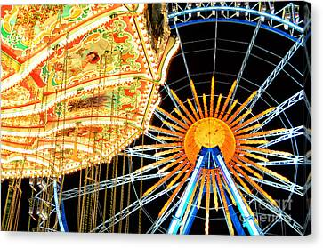 Carousel And Ferries Wheel At Night At The Octoberfest In Munich Canvas Print