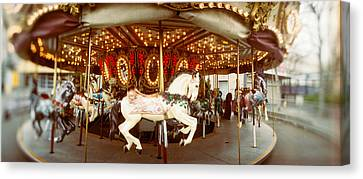 Carousel Horses In An Amusement Park Canvas Print