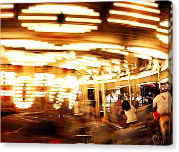 Carousel In Motion Canvas Print by Jp Grace
