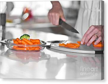 Canvas Print featuring the photograph Carrot Cutting In Kitchen by Gunter Nezhoda