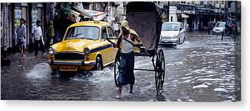 Cars And A Rickshaw On The Street Canvas Print by Panoramic Images