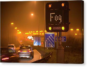 Cars Driving On The M1 Motorway Canvas Print by Ashley Cooper