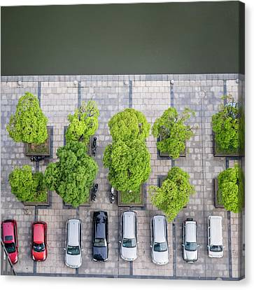 Cars On A Parking Lot Canvas Print by Chinaface