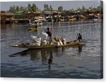 Cartoon - Balancing Large Bags On A Small Boat In The Dal Lake In Srinagar Canvas Print by Ashish Agarwal