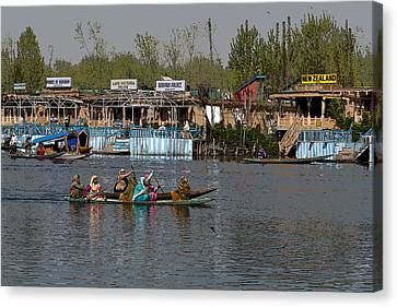 Cartoon - Ladies On 2 Wooden Boats On The Dal Lake With The Background Of Houseboats Canvas Print