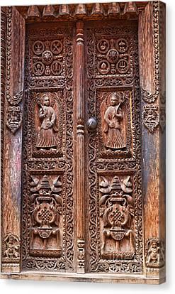 Carved Wooden Door At Bhaktapur In Nepal Canvas Print by Robert Preston