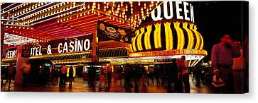 Casino Lit Up At Night, Four Queens Canvas Print by Panoramic Images
