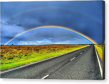Catch The Rainbow Canvas Print by Dave Woodbridge
