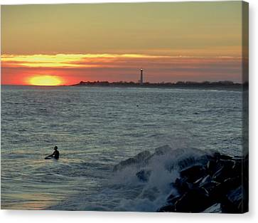 Canvas Print featuring the photograph Catching A Wave At Sunset by Ed Sweeney