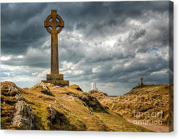 Celtic Cross At Llanddwyn Island Canvas Print by Adrian Evans