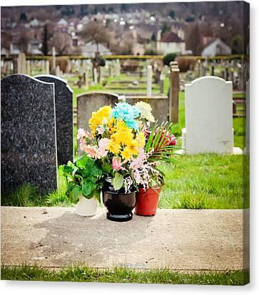 Cemetery Flowers Canvas Print by Tom Gowanlock