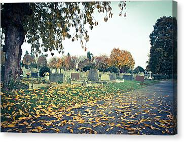 Cemetery In Autumn Canvas Print by Tom Gowanlock