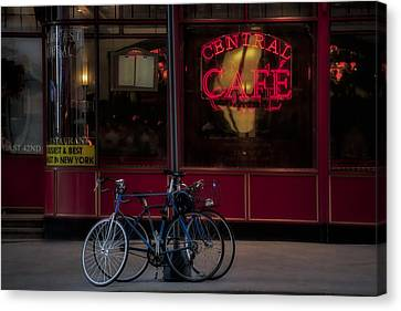 Central Cafe Bicycles Canvas Print by Susan Candelario
