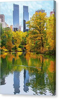 Central Park Pond Autumn Reflections Canvas Print by Regina Geoghan
