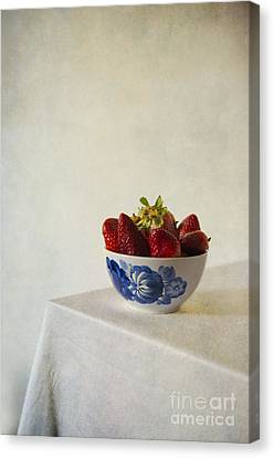 Fresh Strawberries In The White Blue Bowl  On The Table Canvas Print by Jaroslaw Blaminsky