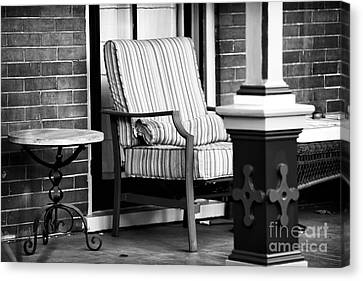 Chair On The Porch Canvas Print by John Rizzuto