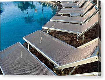 Chairs Around Hotel Pool Canvas Print by Brandon Bourdages