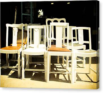 Chairs In White Canvas Print by Sonja Quintero