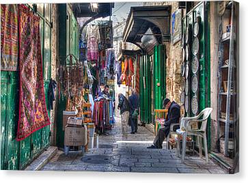 Changing Colors Of The Market Canvas Print by Uri Baruch