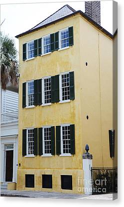 Charleston French Quarter Historical District Yellow House With Black Shutters - Historical Building Canvas Print by Kathy Fornal