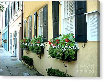 Charleston Houses Canvas Print - Charleston South Carolina - Rainbow Row Yellow Black Shutters Flower Window Boxes - French Quarter  by Kathy Fornal