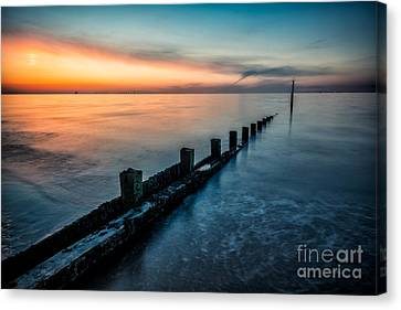 Chasing The Sunset Canvas Print by Adrian Evans