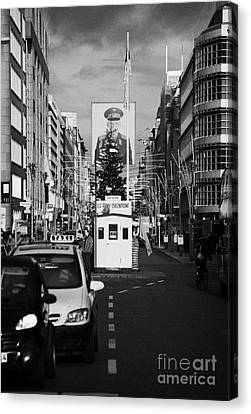 checkpoint charlie ersatz cabin reconstruction in the middle of Friedrichstrasse Berlin Germany Canvas Print