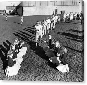 Cheerleaders Canvas Print - Cheerleaders Encourage Football Players by Retro Images Archive