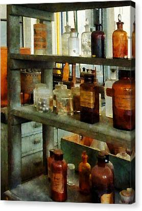 Chemist - Bottles Of Chemicals Tall And Short Canvas Print by Susan Savad