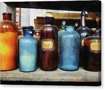 Chemist - Orange Brown And Blue Bottles Canvas Print by Susan Savad