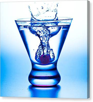 Cherry Splash With Blue Over-tones Canvas Print by John Hoey