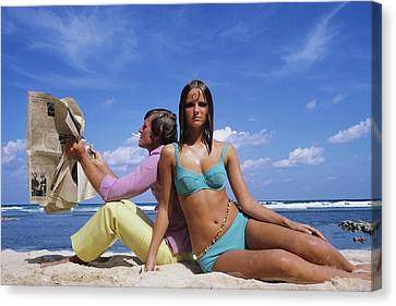 Cheryl Tiegs Modeling A Bikini At A Beach Canvas Print by William Connors