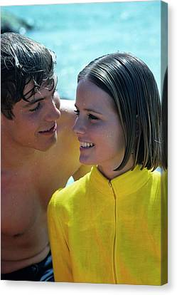 Cheryl Tiegs With A Male Model On A Beach Canvas Print by William Connors