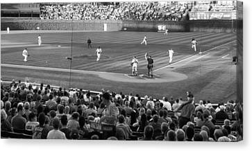 Chicago Cubs On The Defense Canvas Print by Thomas Woolworth
