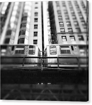 Chicago L Train In Black And White Canvas Print by Paul Velgos