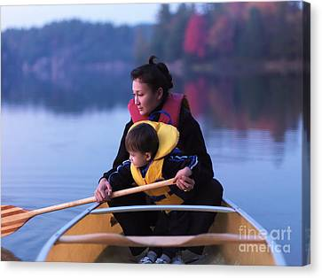 Child Learning To Paddle Canoe Canvas Print by Oleksiy Maksymenko