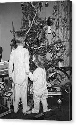 Children Check Christmas Tree Canvas Print by Underwood Archives