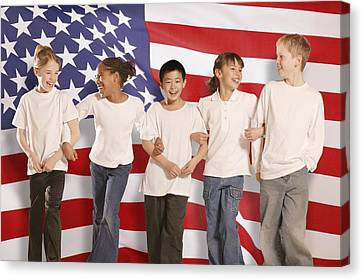 Children In Front Of American Flag Canvas Print by Don Hammond