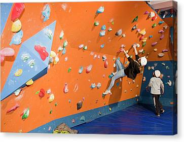 Children On A Climbing Wall Canvas Print by Ashley Cooper