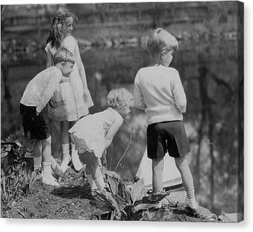 Toy Boat Canvas Print - Children Playing Beside A Pond by Edward Steichen