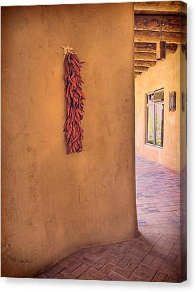 Chili Peppers On Adobe Wall Canvas Print