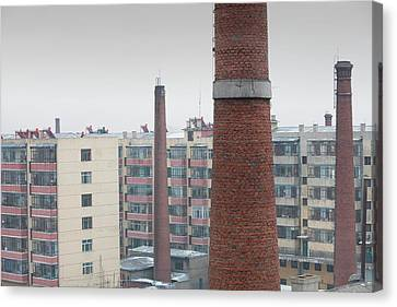 Chimneys And Apartment Blocks Canvas Print by Ashley Cooper
