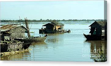 Chong Kneas Floating Village Canvas Print by Rick Piper Photography