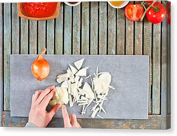 Chopping Onions Canvas Print by Tom Gowanlock